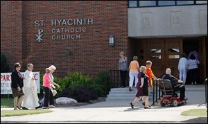 Mourners enter St. Hyacinth Catholic Church early today for Father Gerald Robinson's funeral.