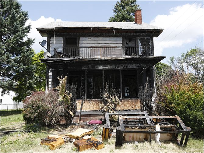 n1burned-3  The fire at 921 Booth Ave. was one of 12 structure fires that took place over the July 4 weekend. Two have been ruled arsons so far, according to Toledo Fire Department spokesman Lt. Matthew Hertzfeld.