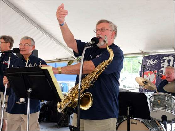 Ron Przybylski of The Polka Zone gets the crowd involved during a performance at the Lagrange Street Polish Festival.