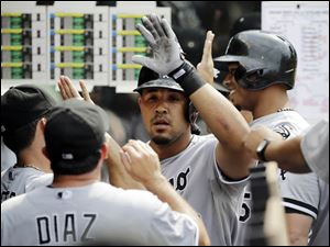 Chicago White Sox's Jose Abreu is greeted in the dugout after hitting a two-run home run.