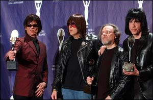 Members of the Ramones, from left to right, Dee Dee, Johnny, Tommy and Marky Ramone hold their awards after being inducted at the Rock and Roll Hall of Fame induction ceremony in this 2002 file photo.