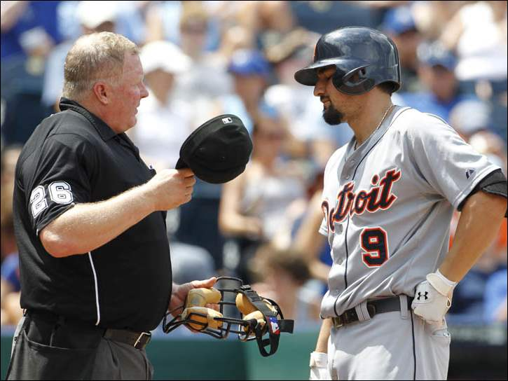 Detroit Tigers' Nick Castellanos talks to umpire Bill Miller after striking out.