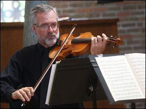 Violinist Philip Singleton performs.