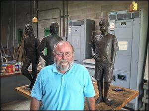 University of Toledo professor Tom Lingeman stands beside his sculptures from the Juvenile Justice Center in Toledo. He is a semifinalist to create a sculpture of Thomas Edison for the U.S. Capitol.
