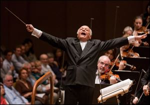 In this June 25, 2009 file photo released by the New York Philharmonic, Lorin Maazel conducts the orchestra at Avery Fisher Hall in New York.