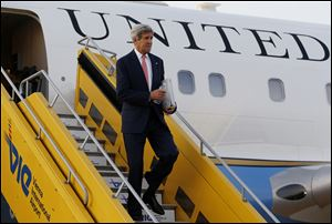 U.S. Secretary of State John Kerry steps out his plane upon arrival at Vienna International Airport for talks with foreign ministers from the six nations negotiating with Tehran on its nuclear program.
