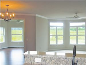 Transoms allow extra sunlight into this open design great room.