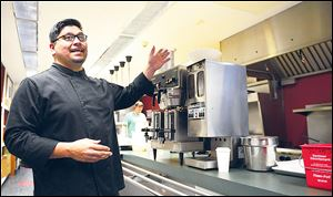 Chef Ruiz explains the features of the museum cafe's kitchen.