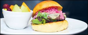 Dill havarti burger with pickled red onions.