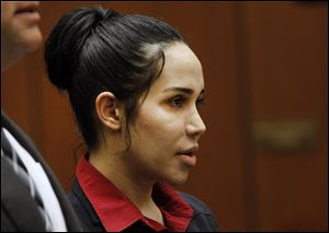 "Nadya Suleman, a single mother of octuplets and six other children, known as ""Octomom,"" appears  for arraignment today in Los Angeles Superior Court."