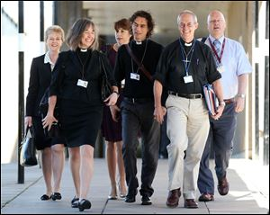 The Archbishop of Canterbury, Justin Welby, second right, and unidentified members of the clergy, arrive for the General Synod meeting today at The University of York, in York England.