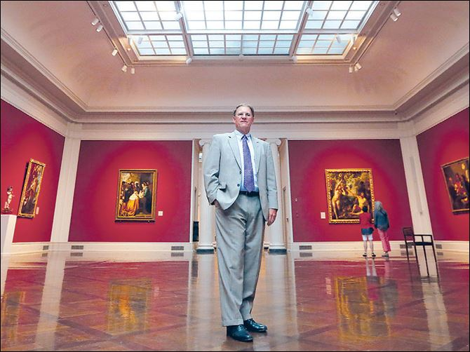 Toledo Museum of Art curator Lawrence Nichols stands in the Great Hall.