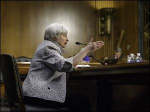 Federal Reserve Chairman Janet Yellen tells Senate Banking Committee continued support is needed to move economy along.