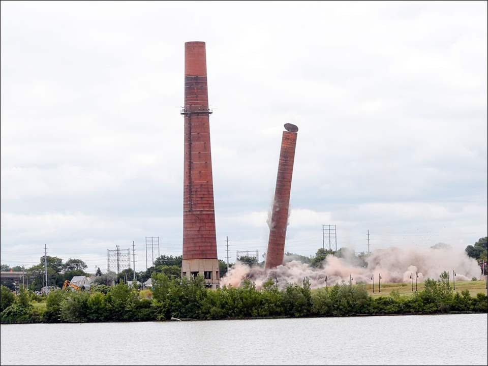 The two smaller smokestacks that were left standing after the decommissioned Acme Power Plant at the East Toledo Marina District are imploded by the city of Toledo.