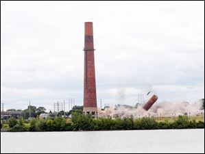 The second smokestack being imploded.