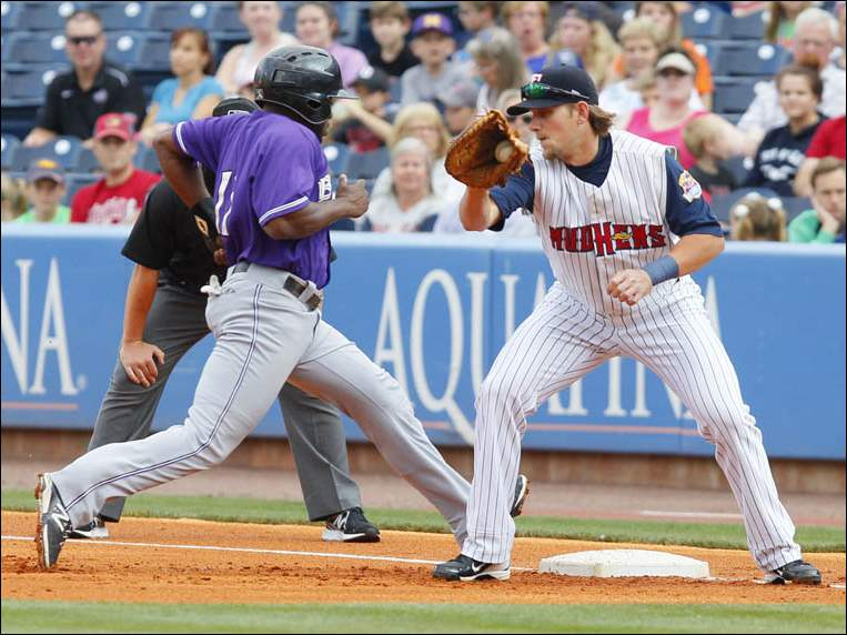 Toledo Mud Hens player Jordan Lennerton can't get the tag in time on a pick off attempt on Louisville Bats player Jason Bourgeous.