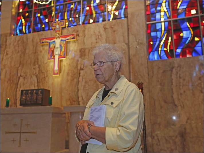 "Sr. Joan Jurski, OSF, speaking about the  San Damiano Cross in Our Lady Queen of Peace Chapel. The cross is a replica of the one in San Damiano, Italy, where ""the crucified Christ spoke to Francis, telling him to ""Go, repair my church"""
