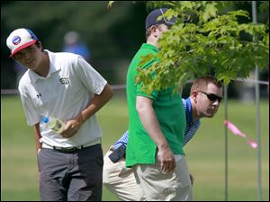 From left: Fans Tommy Hurley, Brad Smith and Ryan Hacker watch the tee shots from Austin Ernst's group.