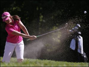 Jackie Gallagher-Smith hits out of a sand trap during the Marathon Classic.