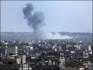 Smoke rises after an Israeli missile strike hit the northern Gaza Strip, Thursday, July 17, 2014. Gaza residents rushed to banks, vegetable markets and shops Thursday during a first U.N.-brokered lull in 10 days of Israel-Hamas fighting,