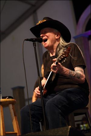 Johnny Winter performs at the New Orleans Jazz & Heritage Festival earlier this year.