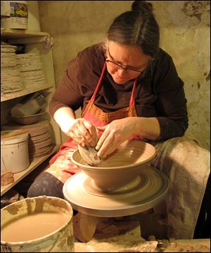 Potter Diana Johnston works in her studio in Mineral Point, Wis. Johnston lives with her husband, Tom, in the malting tower of an old brewery which they have converted into an enormous pottery studio.