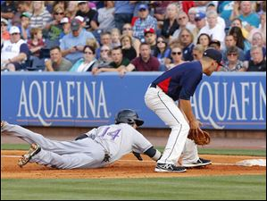 Toledo Mud Hens player Wade Gaynor  can't make the tag in time as Louisville Bats player Feliz Perez (14) dives back to first on a pick off attempt.