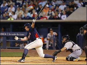 Toledo Mud Hens player James McCann drives in a run.