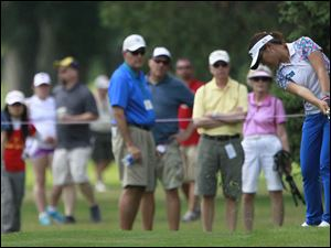 Lydia Ko attracts a gallery as she hits the ball in the fairway on #7.
