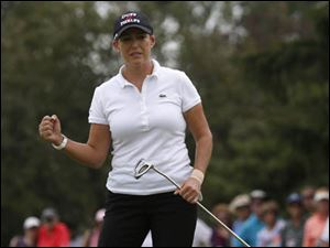 Cristie Kerr pumps her fist after birdying No. 9.