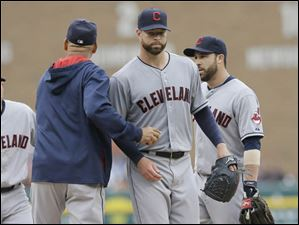Cleveland Indians starting pitcher Corey Kluber is relieved by manager Terry Francona during the ninth inning in the first game of a doubleheader against the Detroit Tigers.