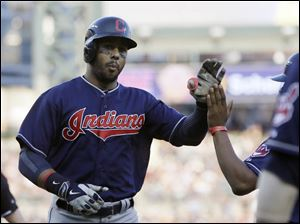Cleveland Indians' Chris Dickerson is congratulated after his solo home run during the third inning in the second game