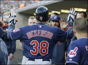 Cleveland Indians' Chris Dickerson is greeted in the dugout after a solo home run.