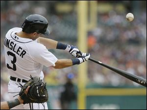 Detroit Tigers' Ian Kinsler bats during the third inning in the first game.