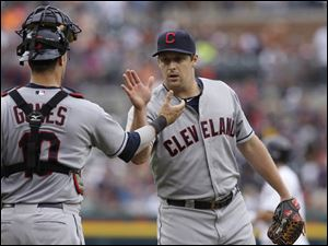 Cleveland Indians relief pitcher Bryan Shaw shakes hand with catcher Yan Gomes after their 6-2 win over the Detroit Tigers in the first game.