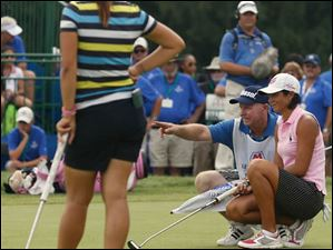 Lydia Ko watches Laura Diaz size up her putt on No. 18.