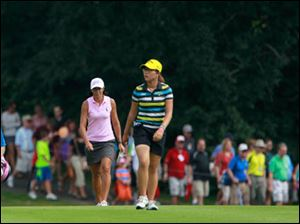 Laura Diaz, left, and Lydia Ko approach No. 18.