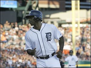 Detroit Tigers' Torii Hunter scores on a bases loaded walk to teammate Austin Jackson in the second game.
