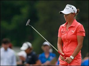 Lee-Anne Pace reacts to missing her birdie putt on No. 18.