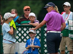 Katherine Kirk pats a boy's head as she departs No. 18.
