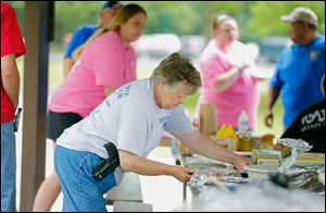 Marge Giznsky, Carleton, Mich., attends the Ohio Carry and Michigan Open Carry picnic in Pearson Metropark in Oregon.