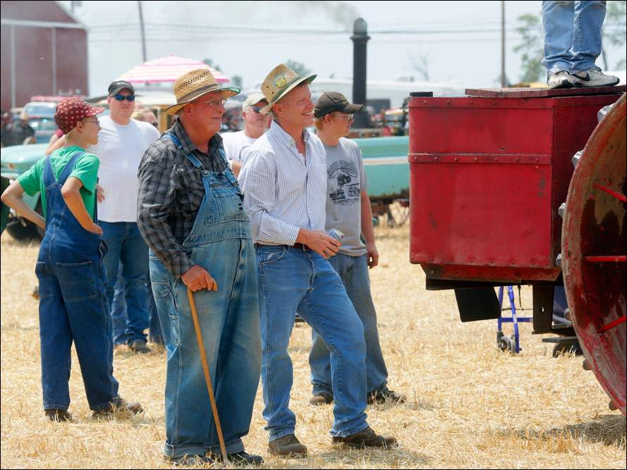 Richard Schmiepp, left, from Edon and Philip Zuver of  from Bryan watch a thresher demonstration.