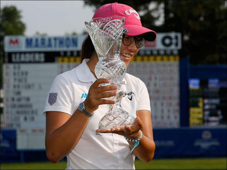 Lydia Ko holds her crystal trophy after winning the Marathon Classic.