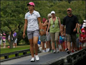 Lydia Ko approaches No. 8 where she birdied and went to -12 during the final round.