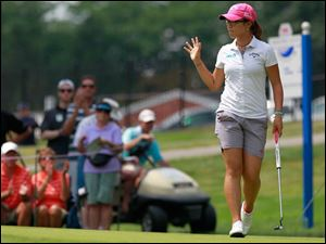 Lydia Ko waves to fans after going to -12 on No. 8 during the final round.