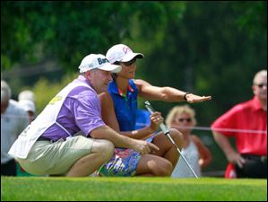 Laura Diaz and her caddie stratagize on No. 8 during the final round of the Marathon Classic.