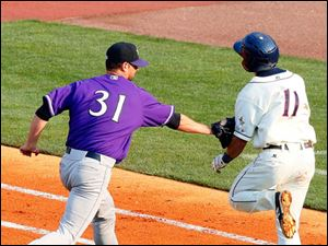 The Hen's second baseman Brandon Douglas is tagged out at first by the Bats' pitcher Scott Diamond.