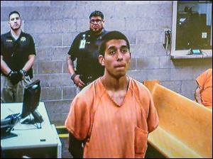 Alex Rios,18, makes an appearance on video for an arraignment in metro court Monday, July 21, 2014 for participating in the beating of two homeless men on the westside in Albuquerque.