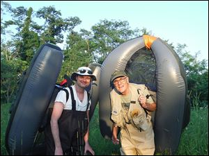 Lee Woldenberg of Perrysburg, right, and his son, Matt, carry float tubes in the secluded strip mine lakes of southeastern Ohio. They fished for bass with  guide Corneilus Harris of Zanesville.