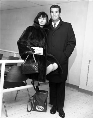 Actor James Garner, right, and his wife Lois are shown in the Trans World Flight Center prior to boarding a TWA Jetliner enroute to London  in this Feb. 21, 1964 file photo taken in New York.